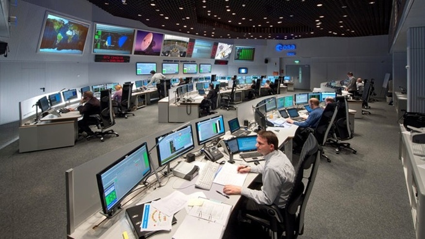 Employees work in the control room of ESA in Darmstadt, Germany. Scientists at the European Space Agency are expecting their comet-chasing probe Rosetta to wake from almost three years of hibernation on Monday Jan. 20, 2014.