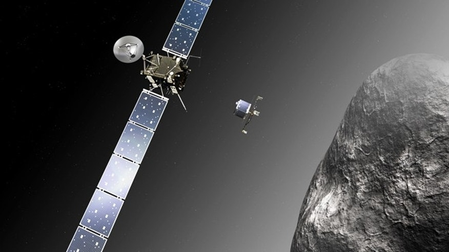 An artists impression of the Rosetta orbiter deploying the Philae lander to comet 67P/ChuryumovGerasimenko.