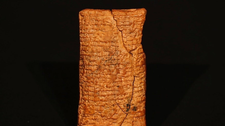 The 4000 year old clay tablet containing the story of the Ark and the flood stands on display at the British Museum in London during the launch of the book 'The Ark Before Noah' by Irving Finkel, curator in charge of cuneiform clay tablets at the British Museum.