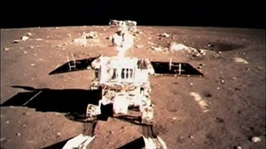 "In this image taken by the on-board camera of the lunar probe Chang'e-3, China's first moon rover ""Jade Rabbit"" touches the lunar surface Sunday, Dec. 15, 2013."