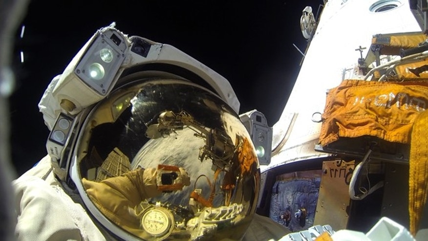 A Russian astronaut on a November spacewalk to install a camera system to the International Space Station, which will stream full color, ultra HD video of Earth.