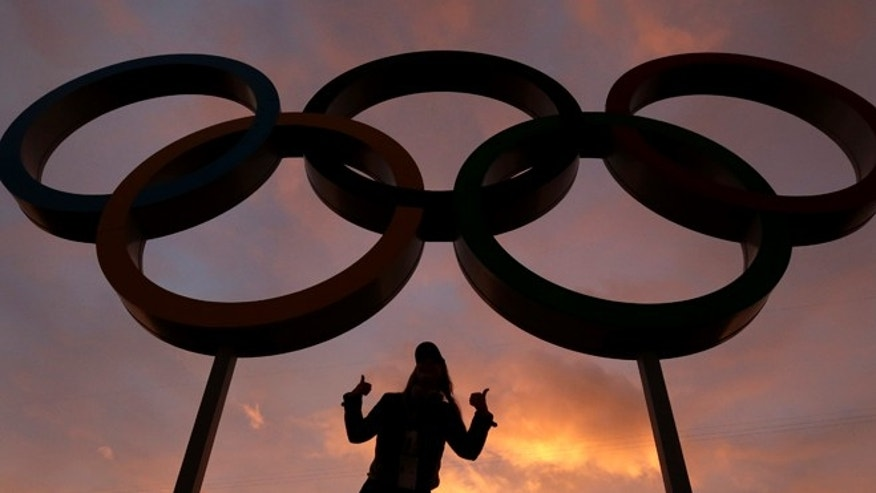 Feb. 5, 2014: A woman poses with the Olympic rings in Olympic Park as preparations continue for the 2014 Winter Olympics in Sochi, Russia.