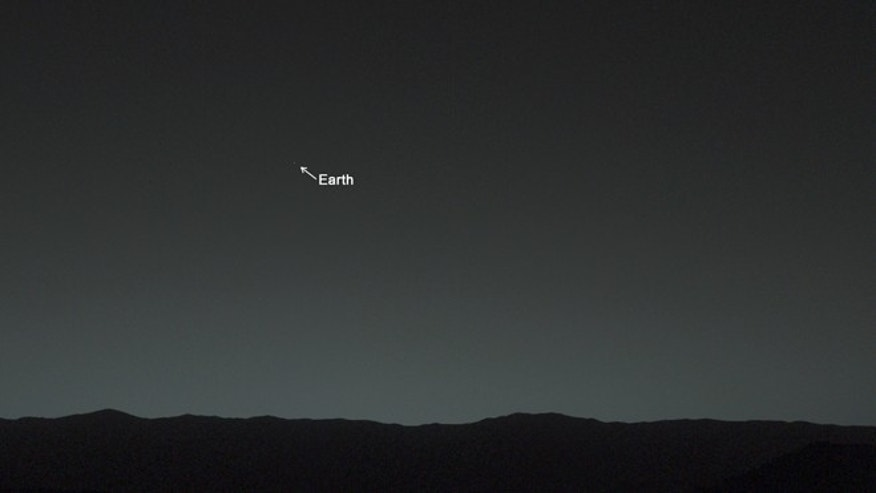 Jan. 31, 2014: This view of the twilight sky and Martian horizon taken by NASA's Curiosity Mars rover includes Earth as the brightest point of light in the night sky.