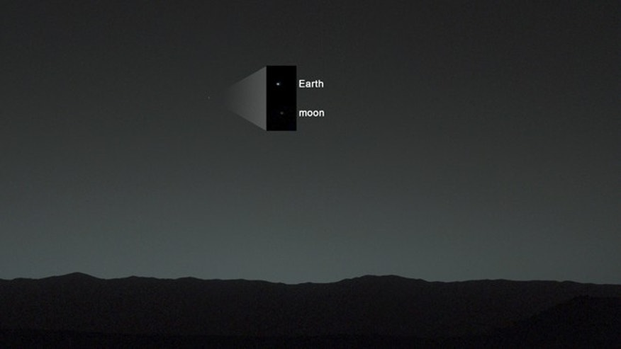 Jan. 31, 2014: This view of the twilight sky and Martian horizon taken by NASA's Curiosity Mars rover includes Earth as the brightest point of light in the night sky, with a faint smudge of moon barely visible.