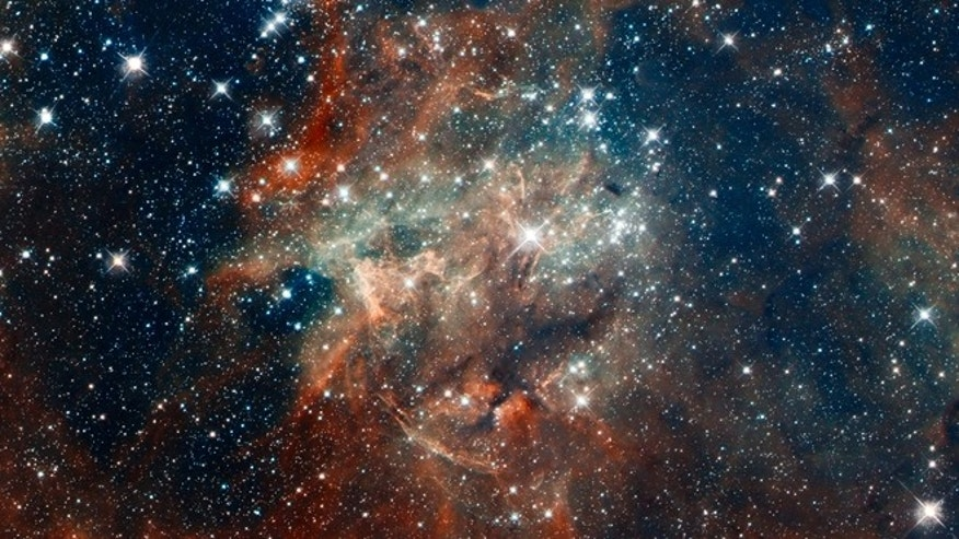 April 17, 2012: A NASA Hubble Space Telescope composite image shows star cluster NGC 2060, a loose collection of stars in 30 Doradus, located in the heart of the Tarantula Nebula 170,000 light years away in the Large Magellanic Cloud, a small, satellite galaxy of our Milky Way.