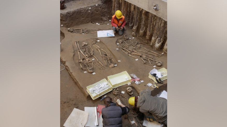 "Feb. 13, 2014: Archaeologists work in an ancient cemetery with dozens of skeletons that was unearthed during works to expand the Uffizi Gallery's exhibit space, In Florence, Italy. In five months of digging, archaeologists uncovered 60 well-preserved skeletons in the cemetery. Archaeologist Andrea Pessina said DNA testing will aim to find evidence of what ""certainly was an extremely lethal epidemic,"" possibly the plague."