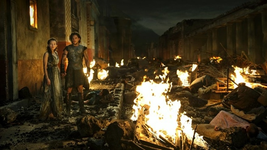"Milo (Kit Harington) with Cassia (Emily Browning) in the TriStar Pictures film ""Pompeii."""