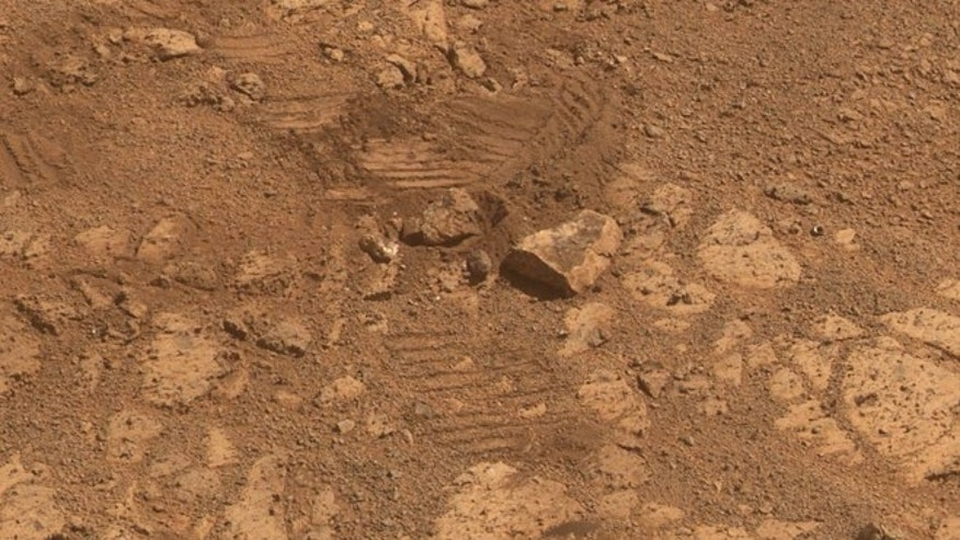 "Feb. 4, 2014: This image from NASA's Mars Exploration Rover Opportunity shows where a rock called ""Pinnacle Island"" had been -- before it appeared in front of the rover in early January 2014."
