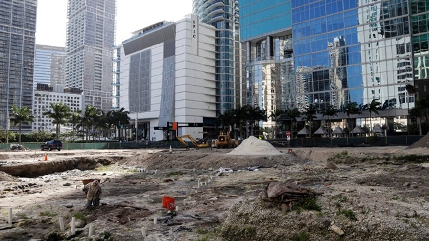 Feb. 4, 2014: People work at a site in downtown Miami, which is likely to be of the most significant prehistoric sites in the United States.