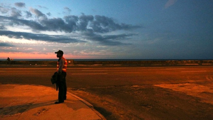 Jan. 26, 2014: A police officer stands guard at the Malecon in Havana, Cuba.
