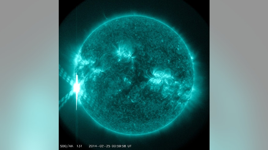 A giant solar flare, an X4.9-class sun storm, erupts from the sun at 00:49 GMT on Tuesday, Feb. 25 (7:49 p.m. Monday, Feb. 24 EST). This image of the flare was captured by NASA's sun-watching Solar Dynamics Observatory.
