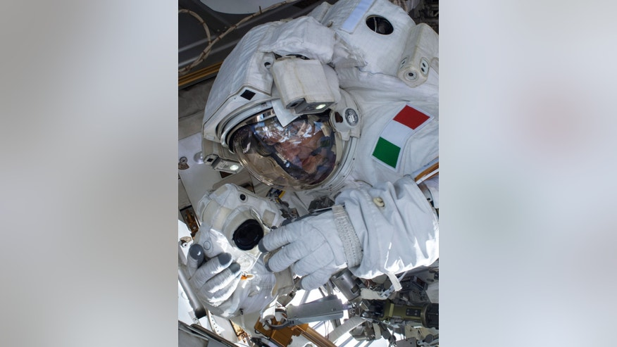 In this Tuesday, July 16, 2013 image provided by NASA, European Space Agency astronaut Luca Parmitano participates in a spacewalk outside the International Space Station.