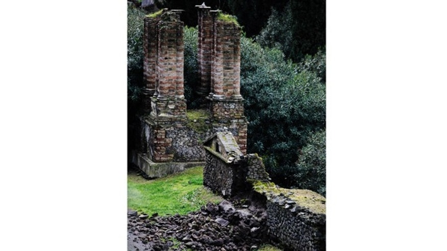 March 2, 2014: Bricks and rocks are seen on the ground after, according to Italian media, they collapsed from the Porta Nocera doorway, in the ancient Roman city of Pompeii, as a consequence of a rainstorm.