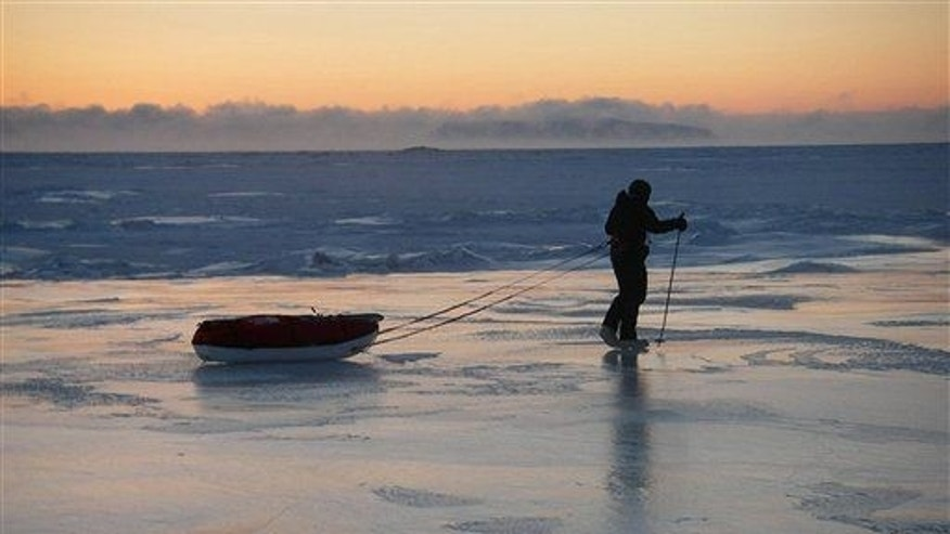 In this 2006 file photo made available by Goliath Earth Trek UK, Briton Karl Bushby walks along the frozen 56-mile stretch of the Bering Straits.
