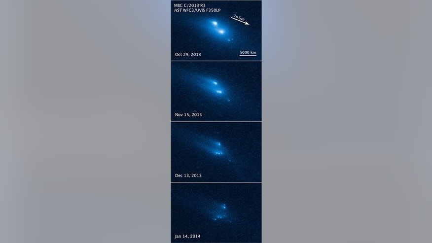 This combination image made available by NASA shows a series of photos from Hubble recording the disintegration of an asteroid from Oct. 29, 2013, to Jan. 14.