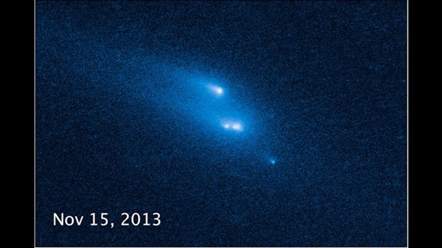 March 6, 2014: One of a series of photos from the Hubble Space Telescope recording the disintegration of an asteroid from Oct. 29, 2013 to Jan. 14, 2014.