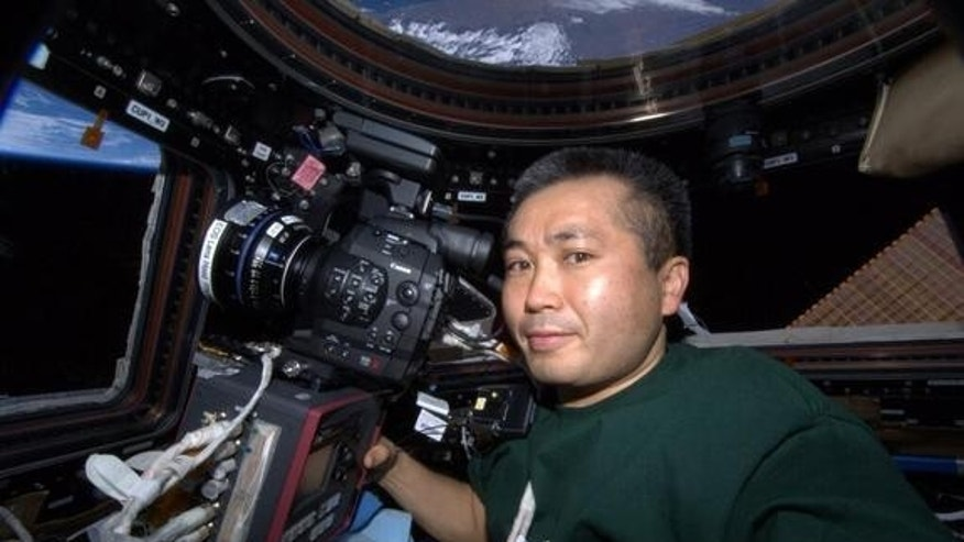 "This photo was taken of JAXA astronaut Koichi Wakata aboard the International Space Station on Dec. 2, 2013.  ""I'm going shooting every day working with ultra-high sensitivity 4K camera in Japan in the cupola of the ISS,"" Wakata tweeted."