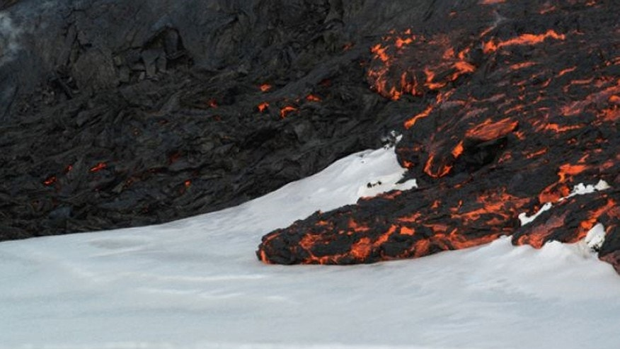In the photo above, lava flows on top of snow at Tolbachik volcano in Russia in April 2013.