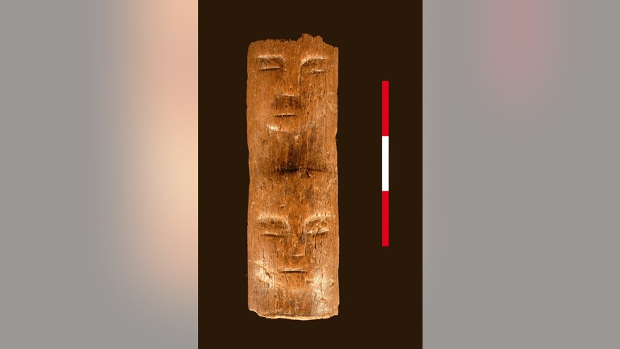 A 9,000-year-old wand with a face carved into it was discovered in Syria.