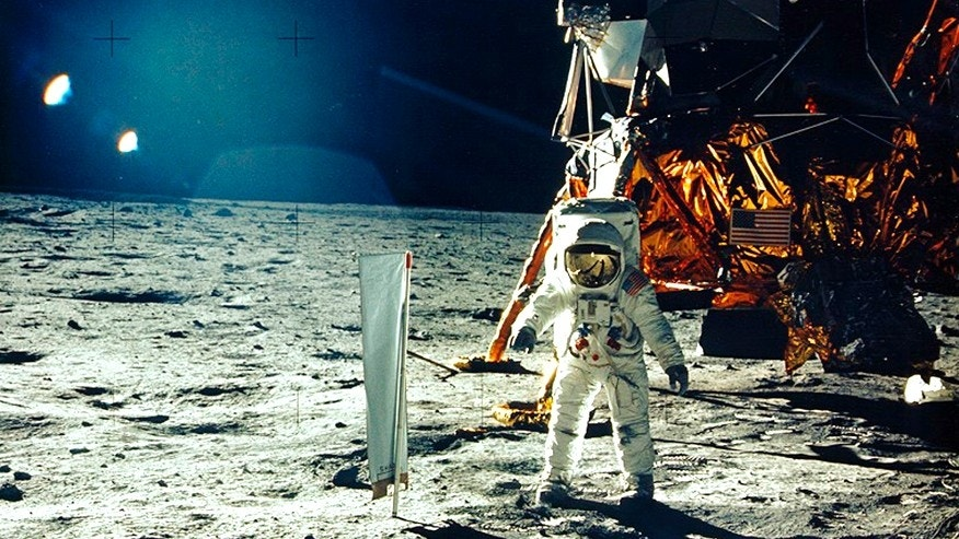 United States astronaut Buzz Aldrin stands beside a solar wind experiment next to the Lunar Module spacecraft on the surface of the Moon after he and fellow astronaut Neil Armstrong became the first men to land on the Moon during the Apollo 11 space mission July 20, 1969.