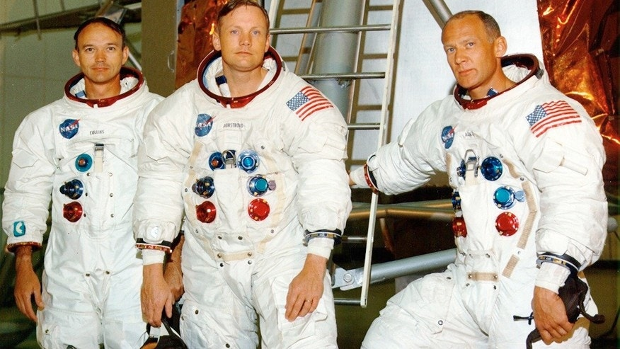 Apollo 11 crew: Michael Collins, Neil Armstrong, and Buzz Aldrin (l-r) posing in front of a LM mock-up.