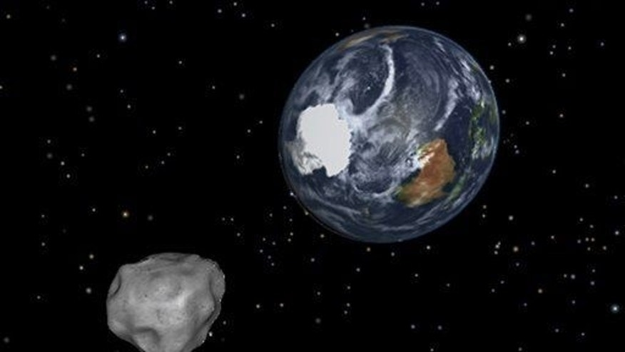 This image provided by NASA/JPL-Caltech shows a simulation of asteroid passing through the Earth-moon system.