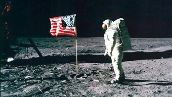 United States astronaut Buzz Aldrin salutes the American flag on the surface of the Moon after he and fellow astronaut Neil Armstrong became the first men to land on the Moon during the Apollo 11 space mission July 20, 1969.