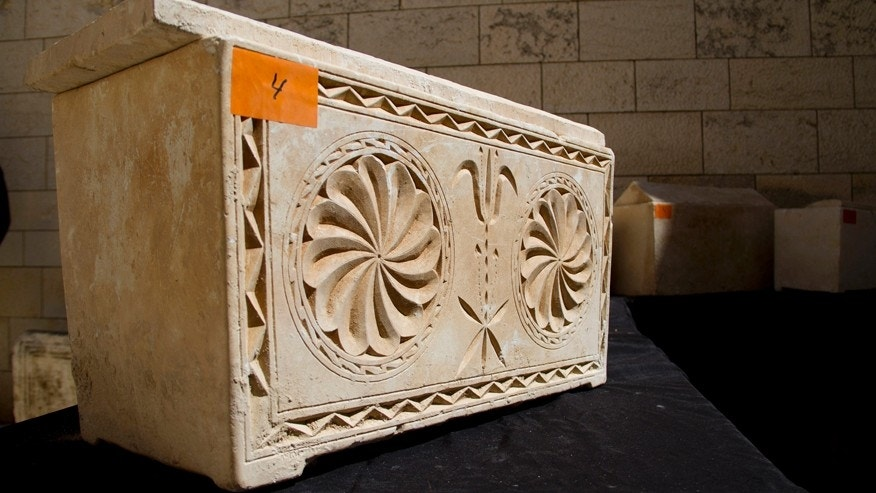 A 2,000 year-old Jewish burial box is on display in Jerusalem Monday, March 31, 2014. The Israeli Antiquities Authority said the boxes were recovered last Friday in Jerusalem when police observed a suspicious nighttime transaction involving two cars, four individuals and the 11 boxes.