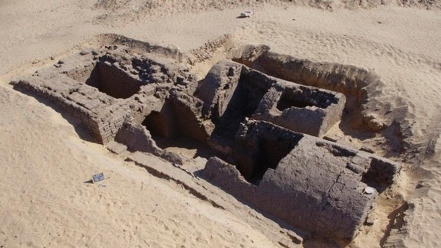 Dating back around 3,300 years this tomb was discovered recently at an ancient cemetery at Abydos in Egypt. At left the rectangular entrance shaft with massive walls served as a base for a small pyramid that was an estimated 23 feet.