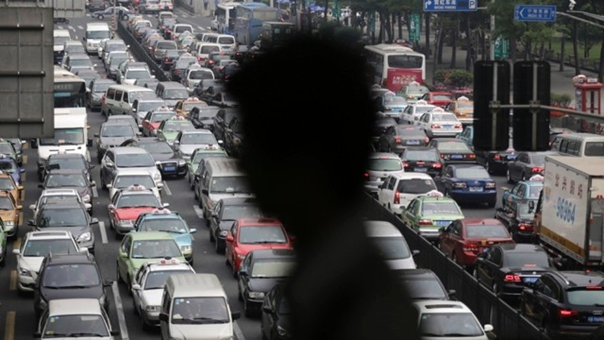 May 29, 2013: A street becomes clogged with traffic in Shanghai, China.  China is now by far the No. 1 carbon dioxide polluter, followed by the United States and India.  (AP Photo/Eugene Hoshiko, File)