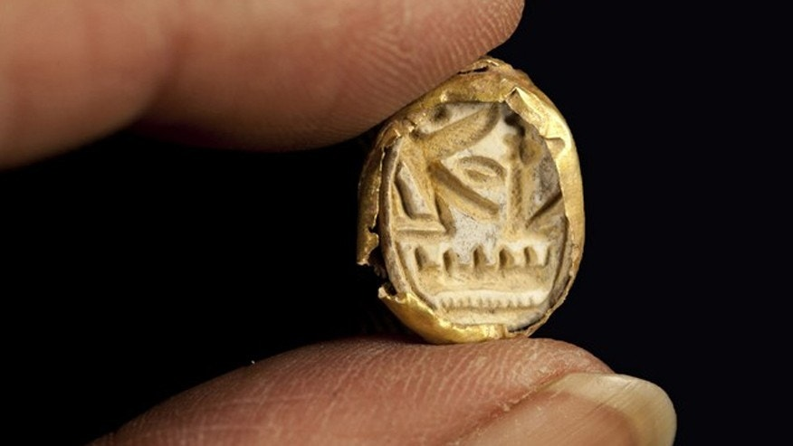 The gold scarab found at the burial site.