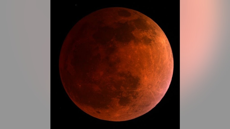 The moon turns blood red in this 3:30 a.m. ET view of the total lunar eclipse on April 15, 2014 as seen by a telescope at the University of Arizona's Mt. Lemmon SkyCenter at Steward Observatory atop Mt. Lemmon, Arizona.