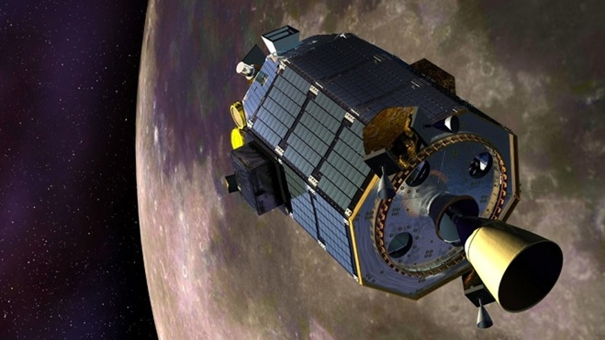 The Lunar Atmosphere and Dust Environment Explorer (LADEE) spacecraft orbits the moon in this artist's rendering.