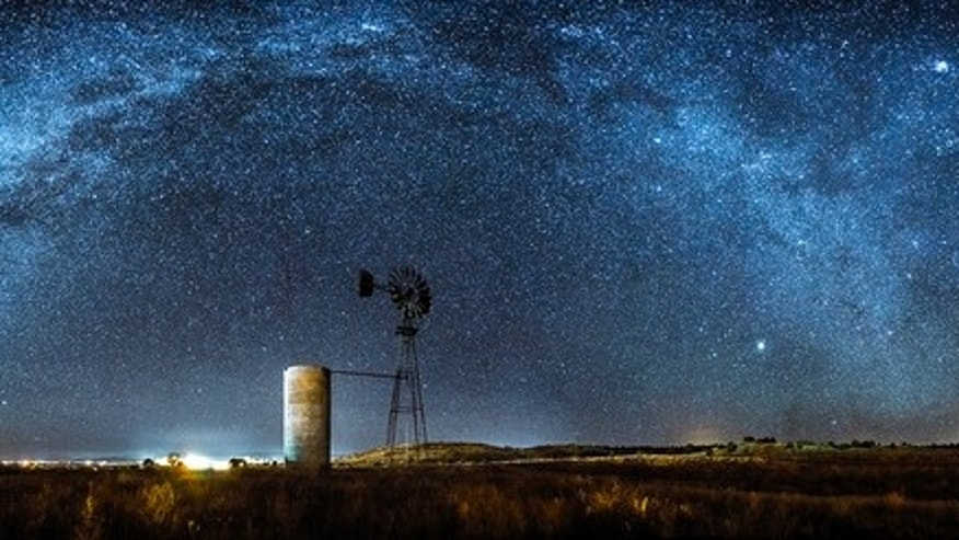 The Milky Way arches over an old windmill near Paulden, Arizona. Astrophotographer Sean Parker sent this image to SAPCE.com on Dec. 30, 2013.