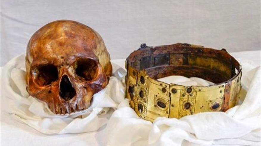 The skull and crown of Swedish 12th century King Erik IX are displayed in Uppsala Cathedral in Sweden on  Wednesday, April 23, 2014.