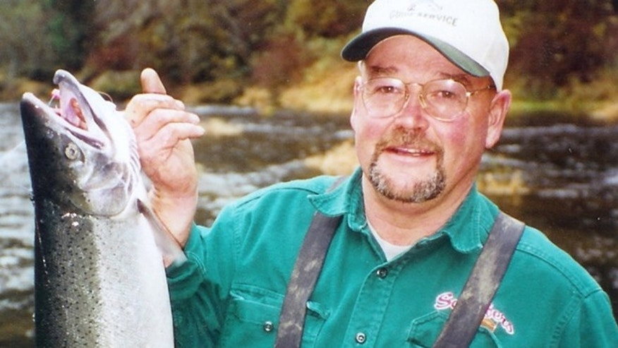 In this undated photo provided by Steve Steele, Stan Steele holds a hatchery steelhead caught on the Alsea River outside Waldport, Ore.
