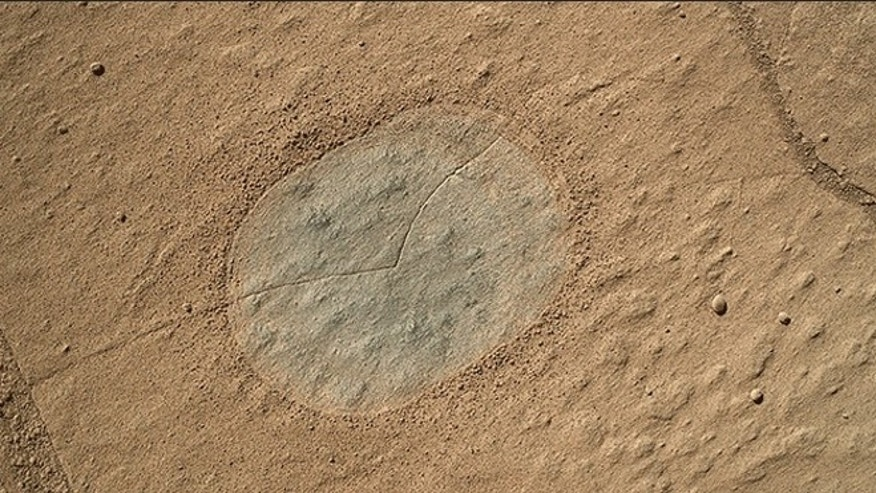 The site on Mars where NASA's Curiosity rover plans to drill to collect a rock sample for analysis.