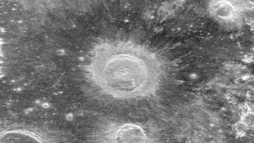 "This image is an observation of the lunar impact crater known as Aristillus. The radar echoes reveal geologic features of the large debris field created by the force of the impact. The dark ""halo"" surrounding the crater is due to pulverized debris beyond the rugged, radar-bright rim deposits."