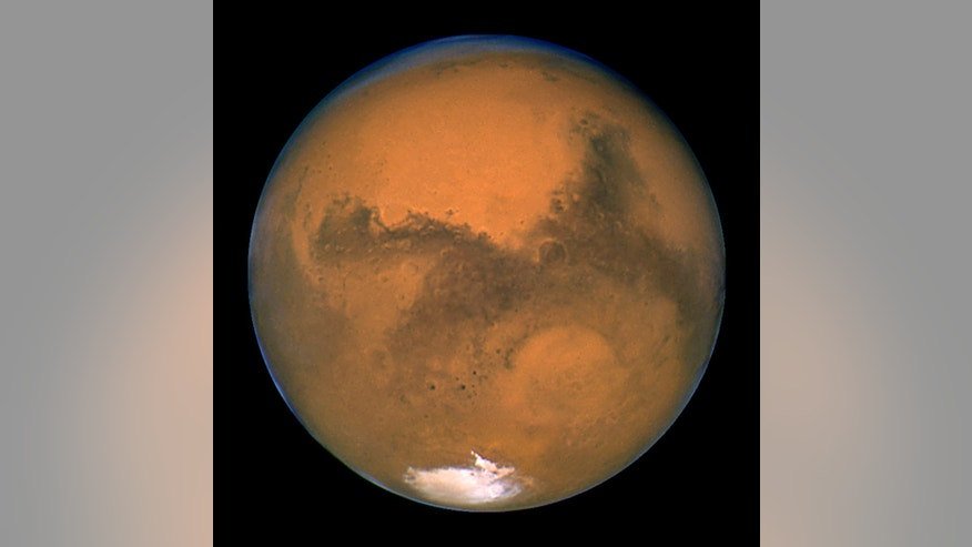 August 27, 2003: NASA&#39&#x3b;s Hubble Space Telescope snapped this portrait of Mars within minutes of the planet&#39&#x3b;s closest approach to Earth in nearly 60,000 years.