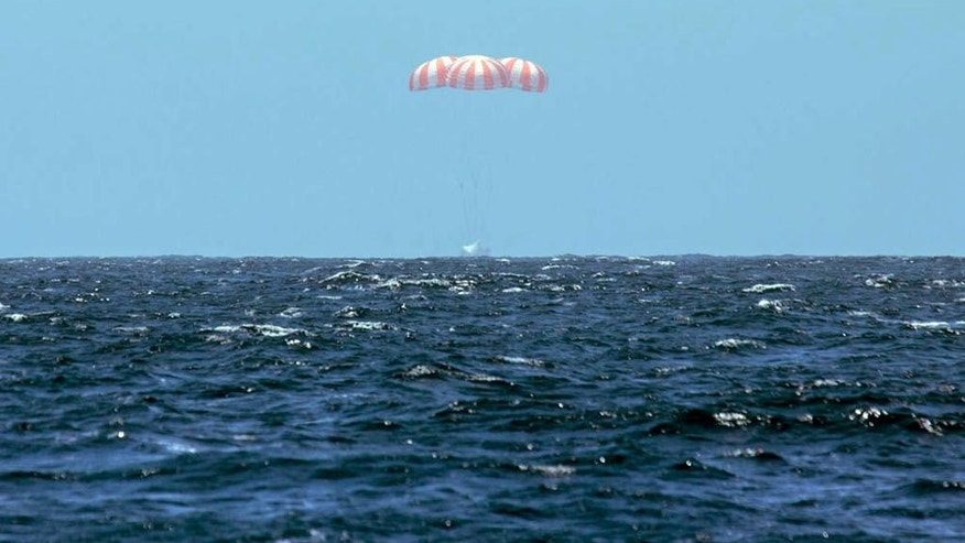 This photo provided by SpaceX shows SpaceX's Dragon spacecraft  splashing down after it successfully completed the CRS 3 mission for NASA, landing safely, Sunday, May 18, 2014, in the Pacific Ocean with 3,500 pounds of ISS cargo.