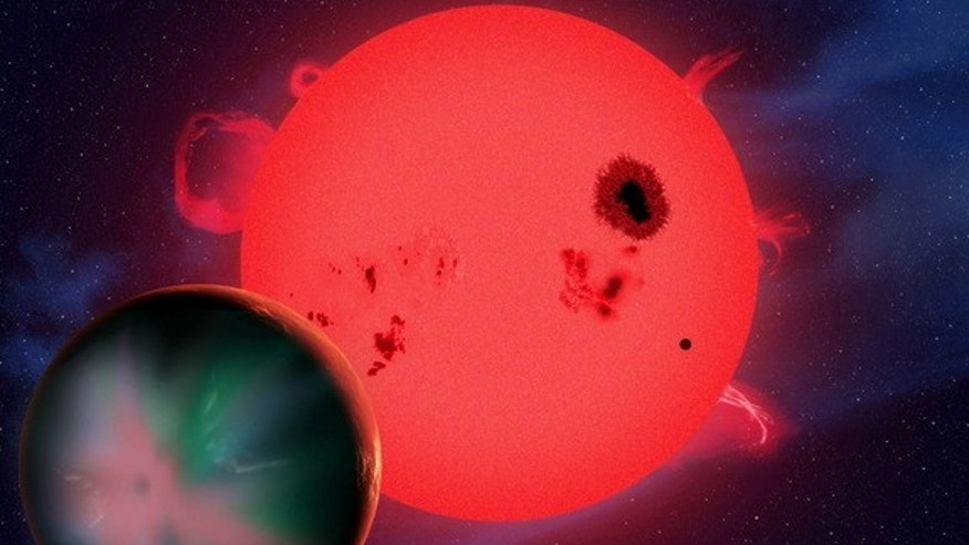 An artist's concept of an alien planet in orbit around a red dwarf star. Severe space weather from red dwarfs, the most common type of star, could doom the chances for life on such planets.