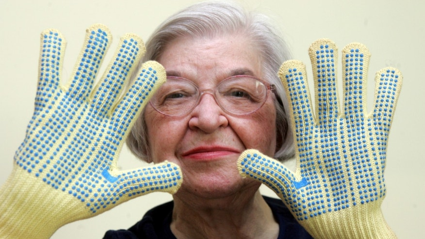 Stephanie Kwolek, 83, shown in this June 20, 2007 file photo taken in Brandywine Hundred, Del.,  she wears regular house gloves made with the Kevlar she invented. Her friend, Rita Vasta, told The Associated Press that Stephanie Kwolek died Wednesday in a Wilmington hospital. at age 90. (AP/The News Journal, Jennifer Corbett)