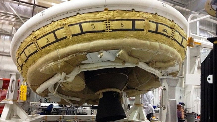 FILE - In this undated file photo provided by NASA, a saucer-shaped test vehicle known as a Low Density Supersonic Decelerator is shown in the Missile Assembly Building at the US Navy's Pacific Missile Range Facility at Kekaha on the island of Kauai in Hawaii.