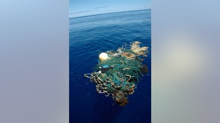 This Aug. 11, 2009 file image provided by the Scripps Institution of Oceanography shows a patch of sea garbage at sea in the Pacific Ocean.