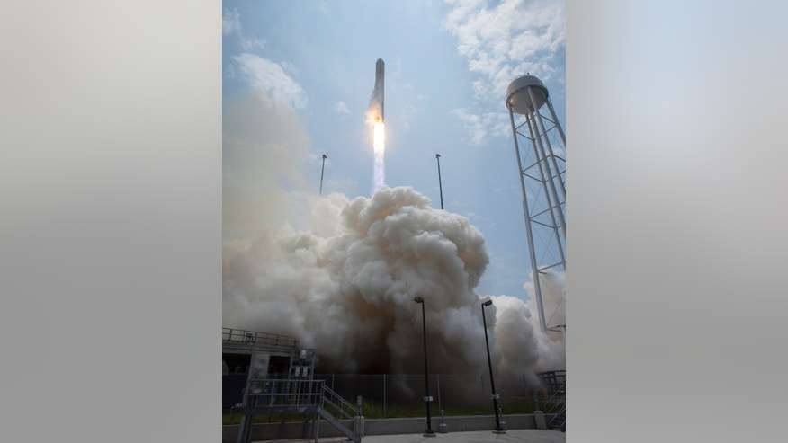 The Orbital Sciences Corporation Antares rocket launches with the Cygnus spacecraft onboard, Sunday, July 13, 2014.