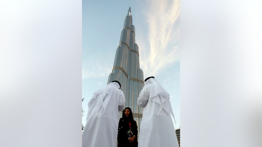 In this Jan. 4, 2010 file photo, Emirati officials prepare for the opening of Burj Khalifa, the world's 828-meter tallest building during the official opening ceremony in Dubai, United Arab Emirates.
