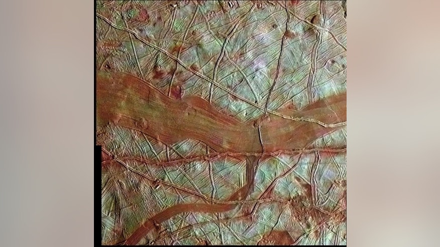 This image, created with data from NASA's Galileo spacecraft, covers a section of Europa 101 miles by 103 miles (163 km by 167 km), with the blue-white areas representing pure water ice, while the reddish areas showing where water ice is mixed