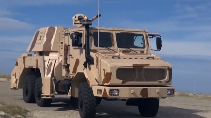 Thales' RAPIDFire weapon is designed to attack aerial and ground vehicles. The truck-mounted gun can shoot down combat drones, helicopters and missiles, according to company officials.