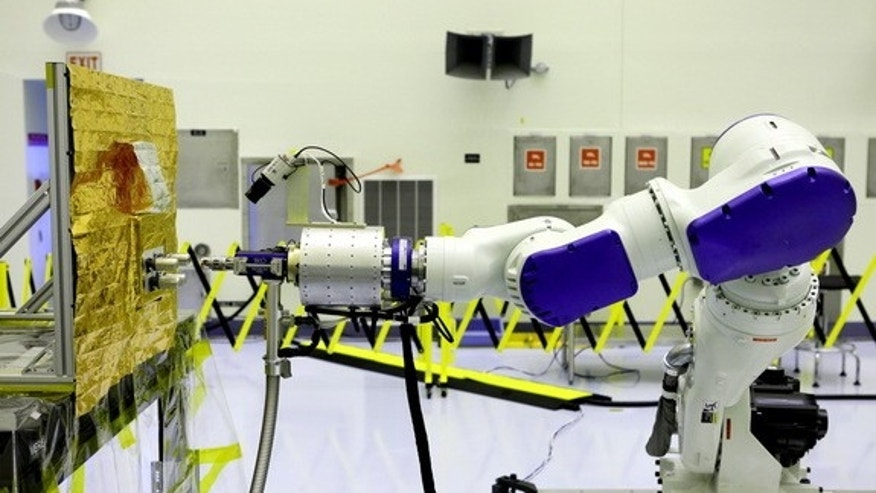 The Remote Robotic Oxidizer Transfer Test (RROxiTT) robot demonstrated a way for future servicing satellites to transfer oxidizer to a satellite in need of refueling, at the Kennedy Space Center's Payload Hazardous Servicing Facility.
