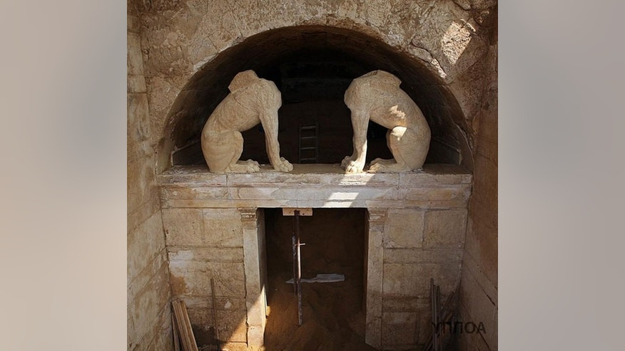 Two sphinxes stand guard at a tomb more than 2,000 years old in Amphipolis. The Greek Ministry of Culture released this image on Aug. 25, 2014, showing the progress that has been made clearing dirt from the entrance.